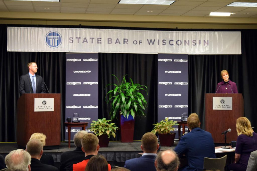 Wisconsin Court of Appeals Judges Brian Hagedorn, left, and Lisa Neubauer, right, debate at the State Bar Center in Madison on Friday, March 15, 2019. Photo by Shawn Johnson/WPR.
