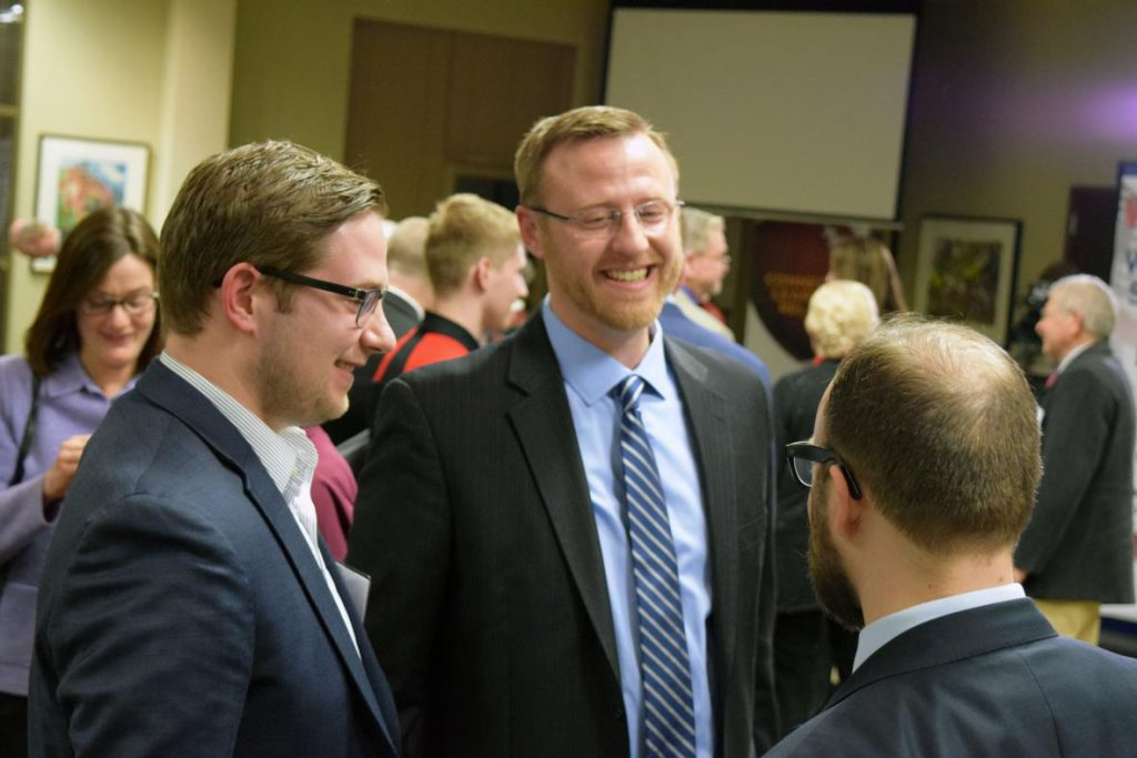 Wisconsin Supreme Court candidate Brian Hagedorn, center, speaks with attendees of a debate for the race held Friday, March 15, 2019. Photo by Shawn Johnson/WPR.
