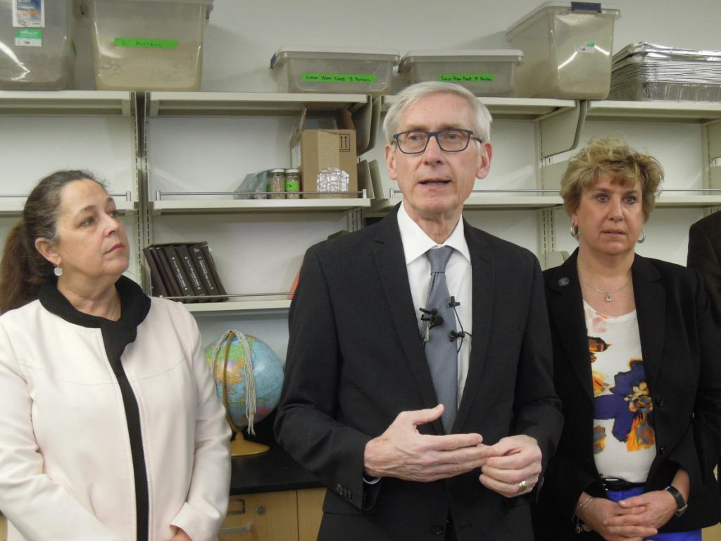 Gov. Tony Evers speaking on Friday, March 22, 2019, in a lab at the University of Wisconsin-La Crosse's Prairie Springs Science Center with state Rep. Jill Billings and state Sen. Jennifer Shilling. Photo by Hope Kirwan/WPR.