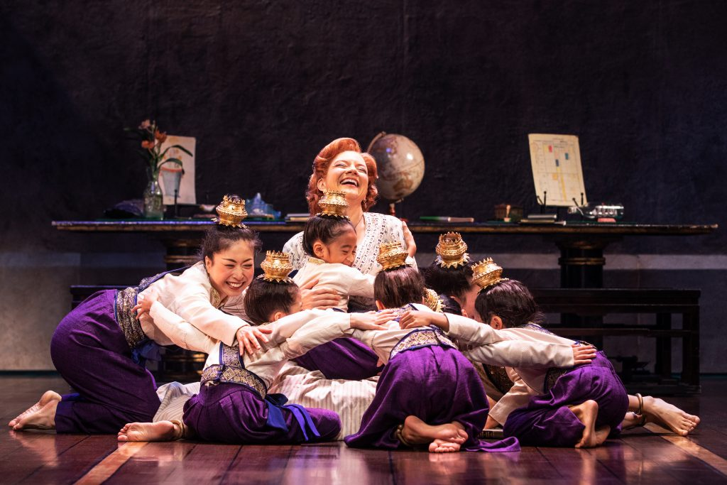 Angela Baumgardner as Anna Leonowens and the Royal Children in Rodgers & Hammerstein's THE KING AND I. Photo by Matthew Murphy.