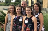 Bailey and Lily Dove, their mother Erin Dove, and father and West Bend director Ryan Dove at the company's fundraising event for the MACC Fund. Photo courtesy of West Bend Mutual Insurance Company.