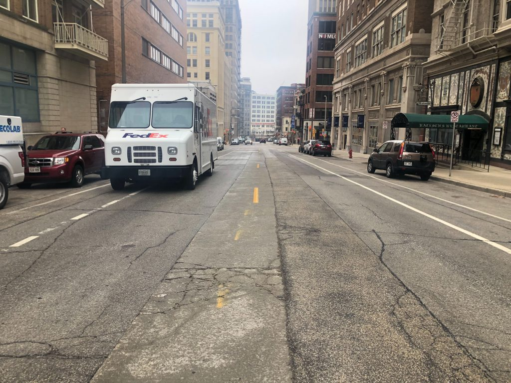 A FedEx truck is parked in the bike lane on E Mason St. Photo by Jeramey Jannene.