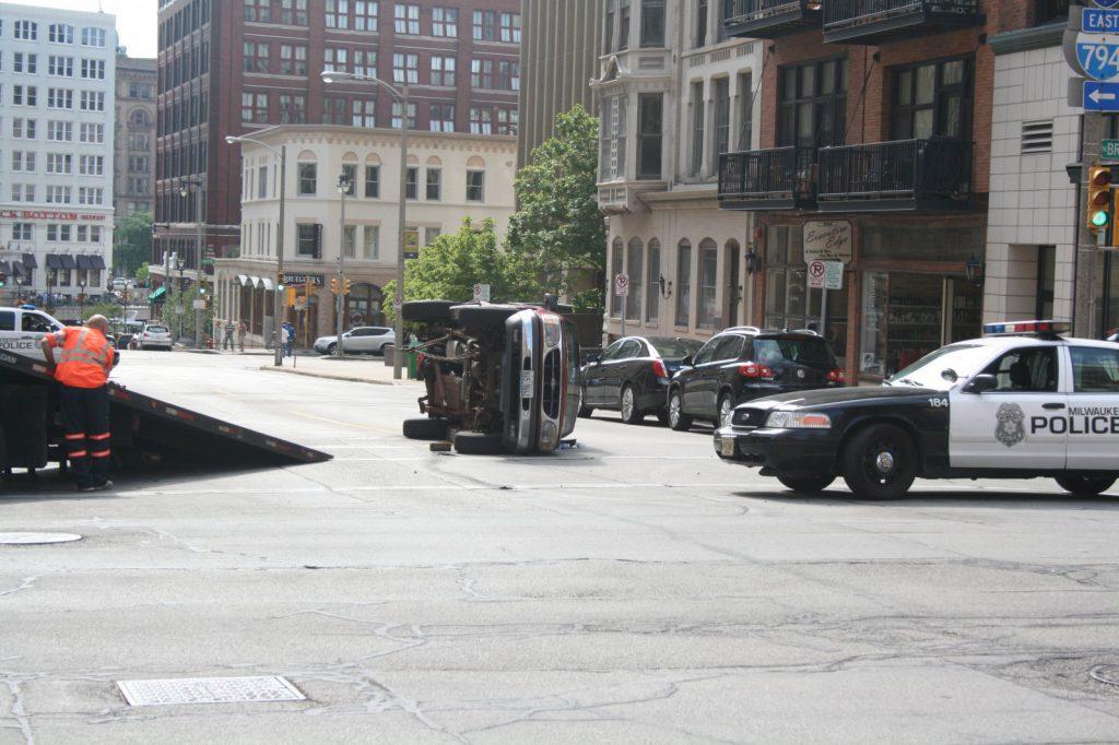 Cleanup after a single-vehicle crash on E. Mason St. File photo by Jeramey Jannene.