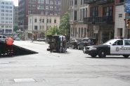 Cleanup after a single-vehicle crash on E. Mason St. Photo by Jeramey Jannene.