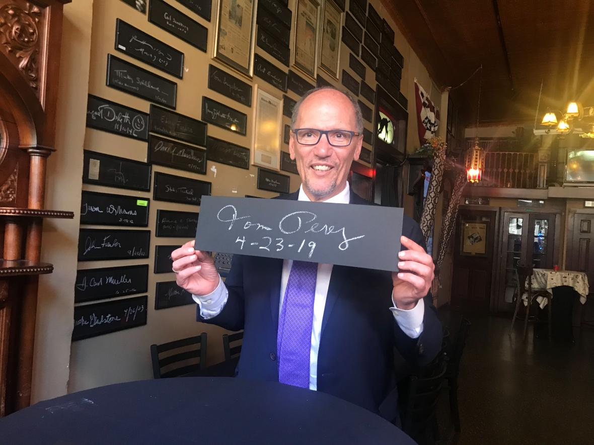DNC Chairman Tom Perez poses with his signature at the Newsroom Pub in Milwaukee on April 23, 2019. Photo by Corrinne Hess/WPR.