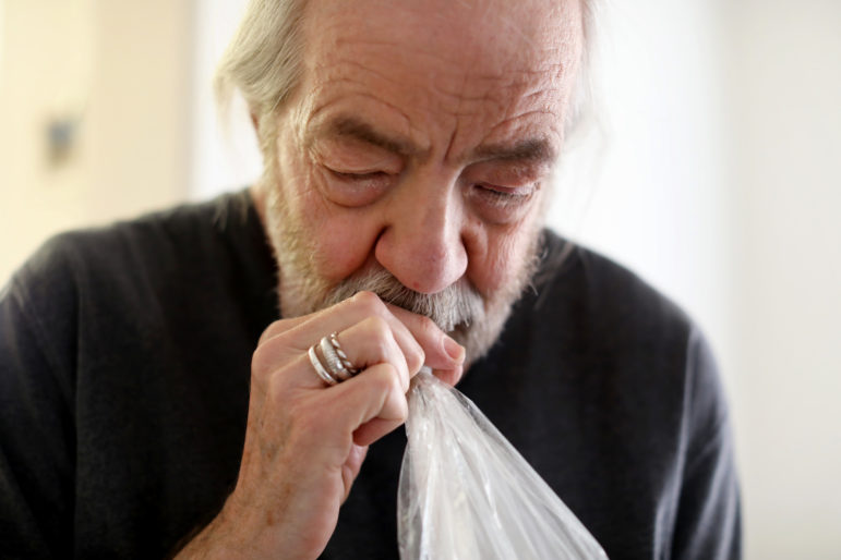 Every two to three hours, Madison, Wis., resident Gary Storck inhales marijuana to relieve the symptoms of glaucoma. Storck is a leading advocate of legalizing marijuana for medical use in Wisconsin. He co-founded the group, Is My Medicine Legal Yet?, and he writes the Cannabadger blog, which tracks proposals to legalize marijuana in Wisconsin. He is seen in his apartment on March 20. Photo by Coburn Dukehart / Wisconsin Center for Investigative Journalism.