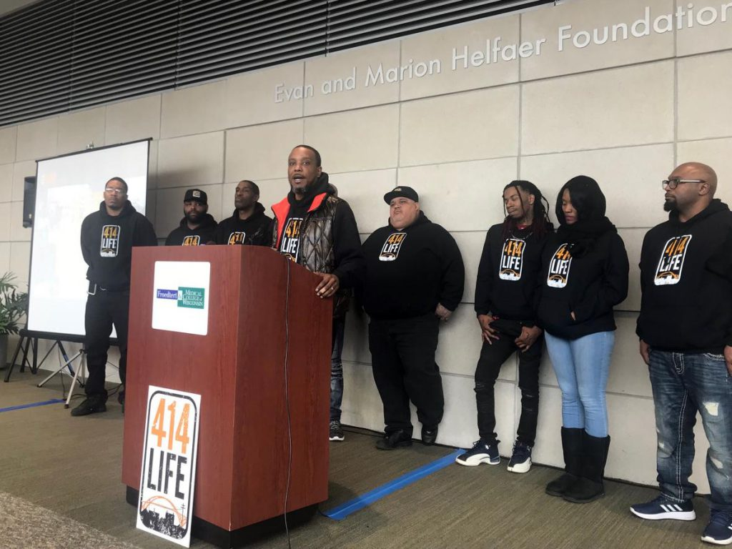 Chris Conley, speaking at the podium, is one of 10 violence interrupters for Milwaukee's new 414Life program. Photo by Corrinne Hess/WPR.