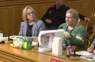 MHD employee Jean Schultz highlights the different lead-safe water filters and products to a Common Council committee. Image from City Channel 25.