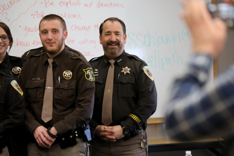 Dane County Sheriff Dave Mahoney greets officers during a Crisis Intervention Training graduation ceremony at the Dane County Law Enforcement Training Center in Waunakee, Wis., on March 15. The Democratic sheriff says he favors decriminalizing possession of small amounts of marijuana, as Dane County already has done, and legalizing cannabis for medical uses. But he opposes full legalization until more studies are done about its effects in other states. Photo by Coburn Dukehart / Wisconsin Center for Investigative Journalism.