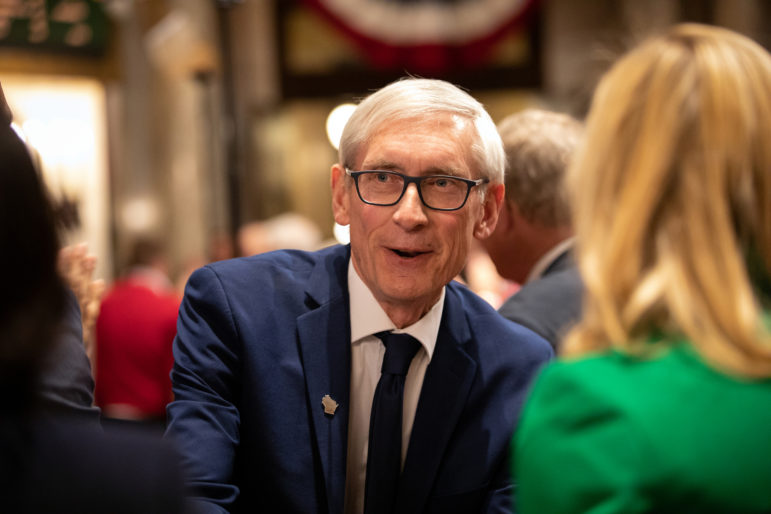 Wisconsin Gov. Tony Evers has proposed decriminalizing possession of small amounts of marijuana, legalizing cannabis for medical uses and expungement for past marijuana possession convictions. Here he greets members of the Assembly and Senate after giving his first State of the State address in Madison, Wis., at the State Capitol on Jan. 22. Photo by Emily Hamer / Wisconsin Center for Investigative Journalism.