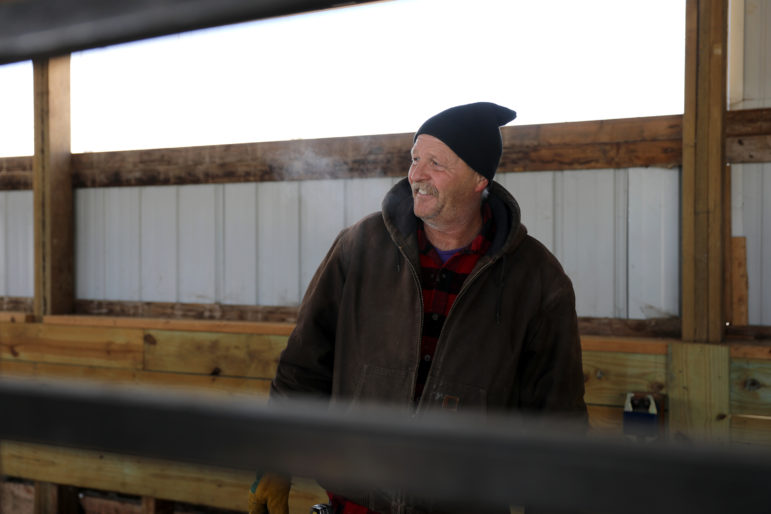 Micah Bahr is seen on his farm in the town of Kendall, Wis., on Feb. 15. He says he has gotten headaches from nearby wind turbines and is opposed to proposed wind projects coming to southern Wisconsin. Photo by Emily Hamer / Wisconsin Center for Investigative Journalism.