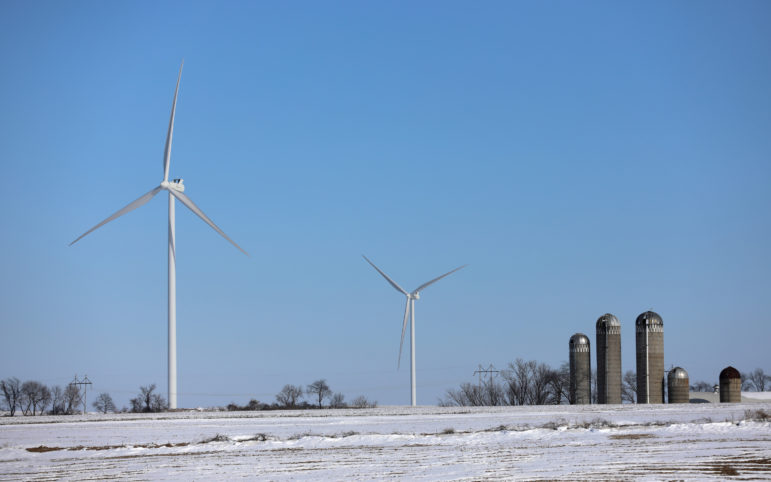 Wind turbines are seen in the town of Seymour, Wis., in Lafayette County near the Illinois border on Feb. 15. Other towns in southern Wisconsin could soon see wind projects. According to the U.S. Wind Turbine Database, these turbines are between 150 and 155 meters — the same height as the ones planned for the town of Jefferson in Green County, Wis. Photo by Emily Hamer / Wisconsin Center for Investigative Journalism.