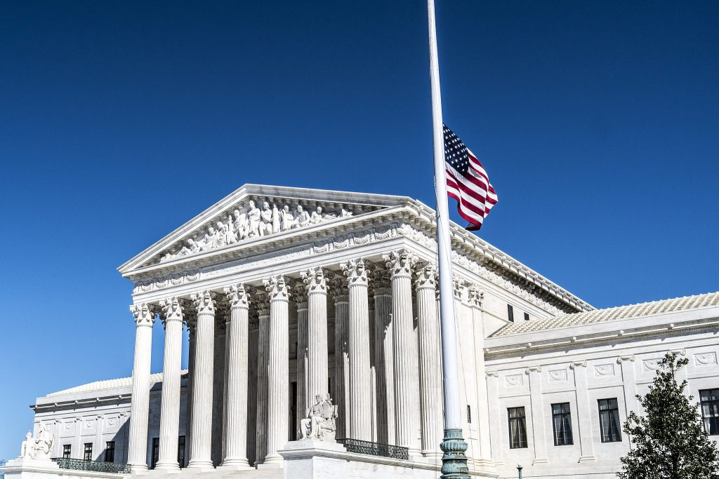 The U.S. flag flies at half-staff over the U.S. Supreme Court Building in Washington, D.C. on Feb. 26, 2016 in observance of the death of Justice Antonin Scalia, who died on Feb. 13. Photo by Phil Roeder (CC BY 2.0).
