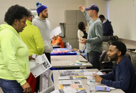 Demetrius Johnson (right) shares information with attendees about how to get into the construction and manufacturing industries. Photo by Allison Dikanovic/NNS.