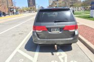 Minivan parked in the E. Kilbourn Ave. bike lane. Photo by Dave Reid.