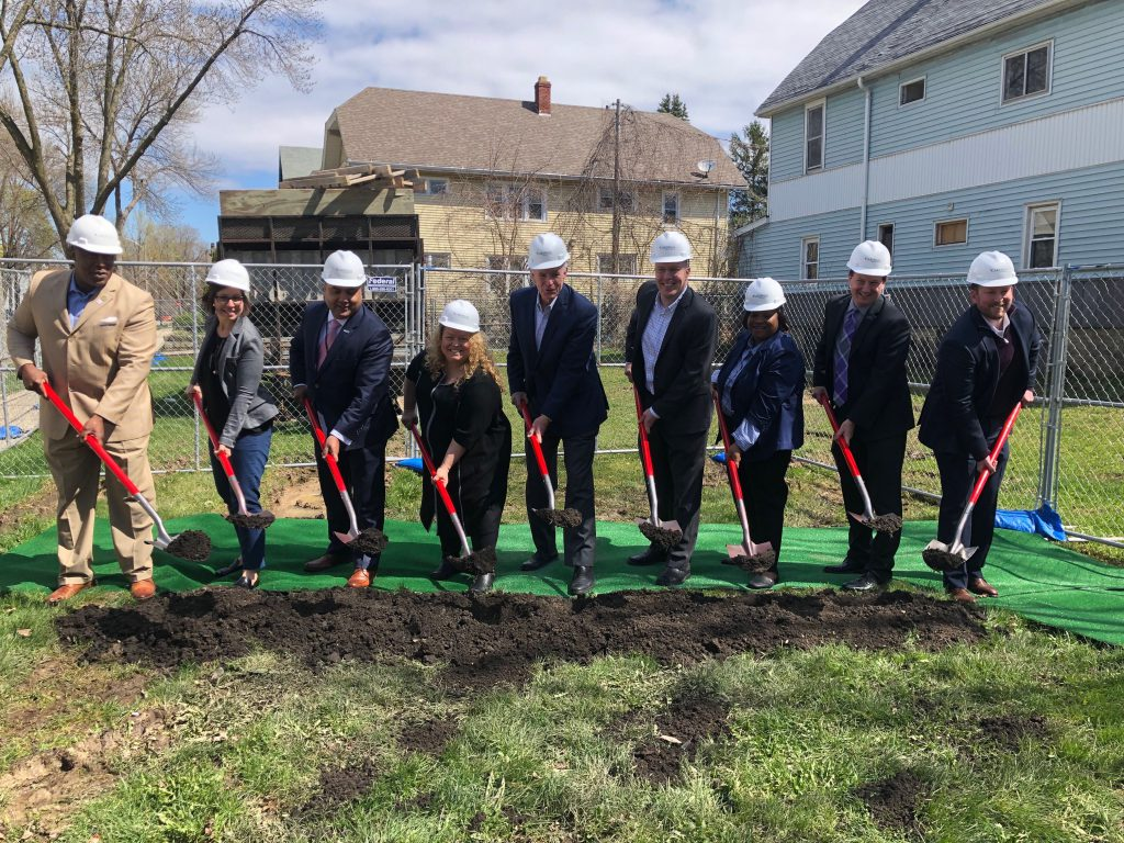 Clarke Square Apartments groundbreaking. From left: Steve Mahan, Emily Burt, Eugene (Gene) Manzanet, Michele Bria, Tom Barrett, Bob McCormick, Tyna Rule, James (Jim) Mathy, Sean Lavin. Photo by Jeramey Jannene.
