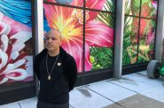Artist Carlos Rolón poses in front of Gild the Lilly at the Chase Tower. Photo by Jeramey Jannene.