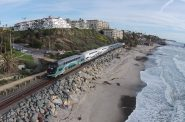 A Metrolink train operating in San Clemente, CA. Cars to be repaired in Milwaukee are in white. Photo by Andrewaronoshn. Licnesed under CC BY-SA 4.10