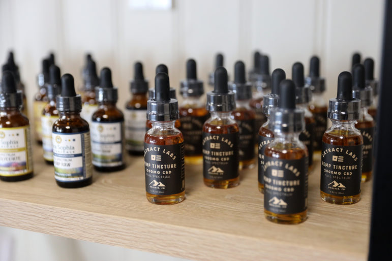 Hemp tincture, also known as hemp oil, is seen at Wellflower, a shop that sells CBD products and hemp flower in Madison, Wis., on March 28. Photo by Emily Hamer / Wisconsin Center for Investigative Journalism.