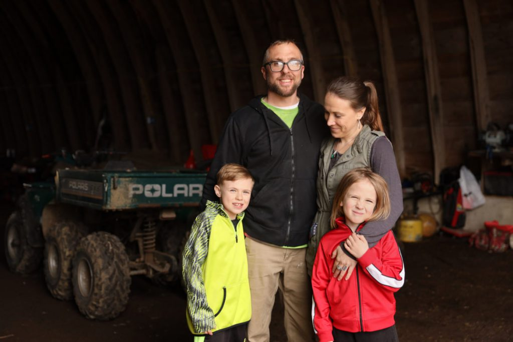 Jody and Abbie Testaberg are seen on their hemp farm, Kinni Hemp Co., along with their sons Aki, 8, and Ari, 6, in River Falls, Wis., on April 18, 2019. The Testabergs grow industrial hemp and plan to build greenhouses and indoor growing rooms. Wisconsin recently legalized growing and selling of hemp, which is from the same family as the marijuana plant. Some growers say they are producing hemp in anticipation of possible legalization of medical or recreational cannabis in Wisconsin. Photo by Emily Hamer/Wisconsin Center for Investigative Journalism.