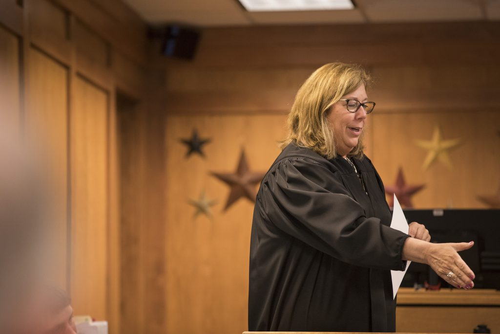 Waukesha County Judge Laura Lau shakes a participants hand during a Waukesha County OWI court hearing Thursday, April 11, 2019. The treatment court is meant as a way to keep drugged and drunken drivers accountable for their actions while also providing the rehabilitation necessary to make them safer, contributing members of society. Photo by Darin Dubinsky/WPR.