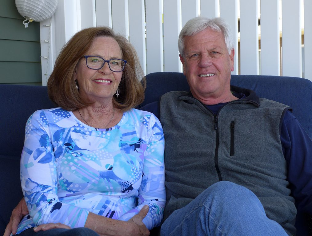 Foster parents Mike and Karen Desmond in their La Crosse, Wis home. Photo by Hope Kirwan/WPR.