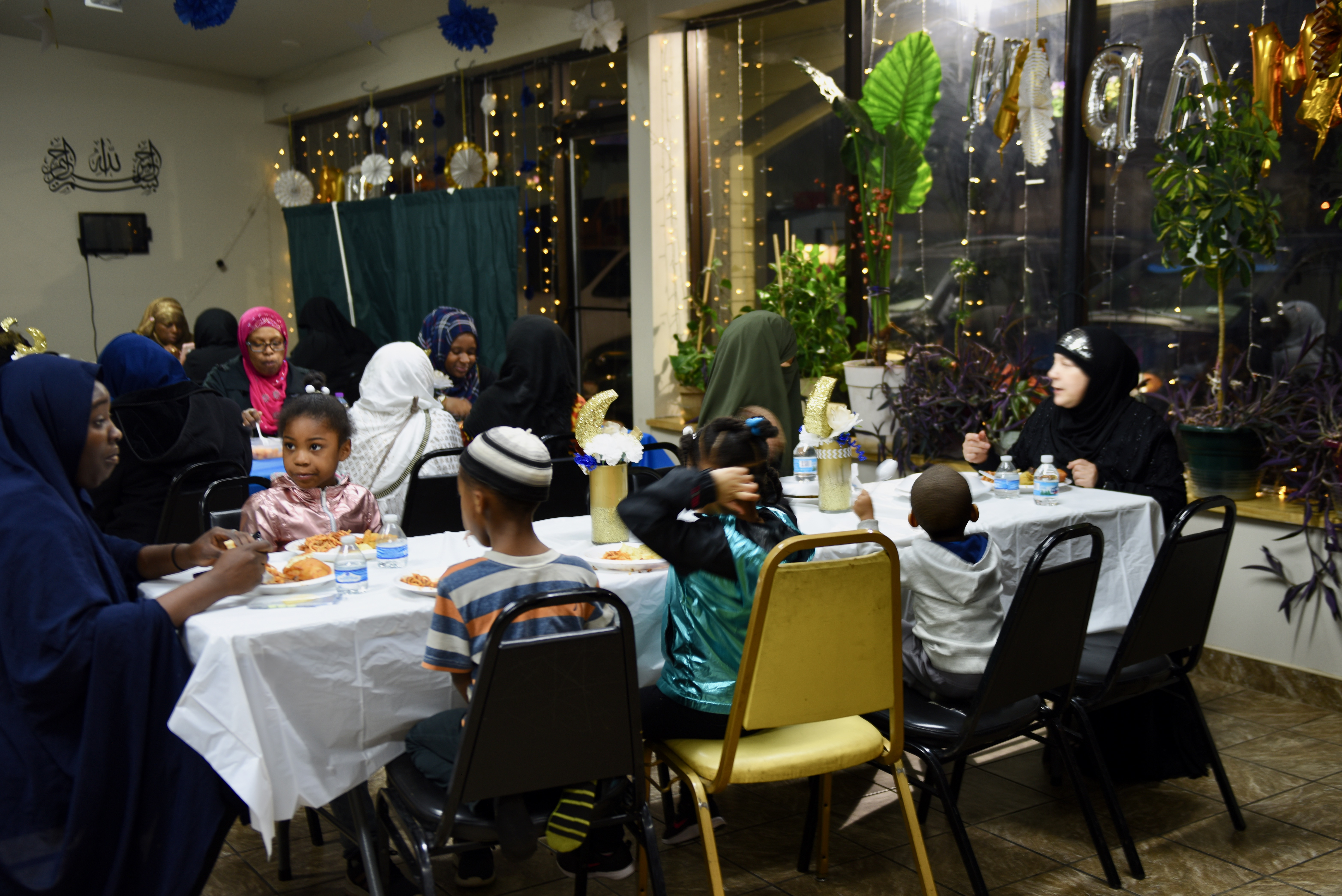 Women and child eat separately from men at the Dawah Center. Photo by Sue Vliet/NNS.