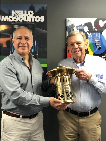 Juan Rocha, President and Jim Hunter, Chairman were presented a 24-carat gold plated DynaTrap® by the principal supplier in commemoration of over 2 million traps produced. Photo courtesy of Dynamic Solutions Worldwide, LLC.