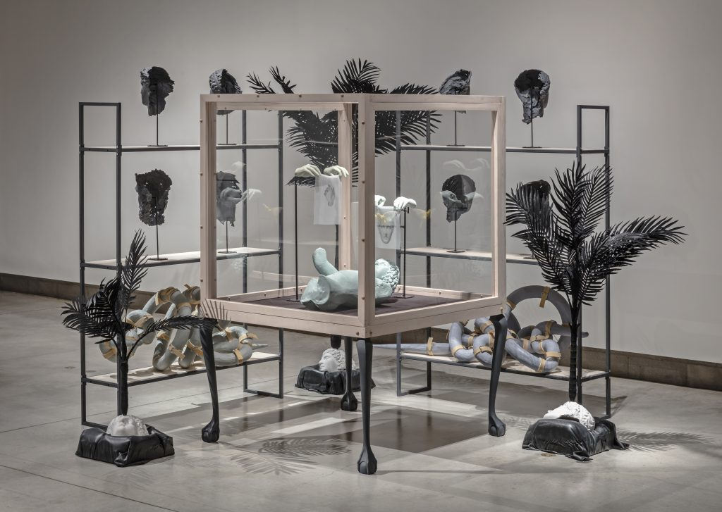 Prone 2017. Wood, steel, ceramic, glaze, gum rubber, wool felt, cast acrylic, flocking, plaster, latex, rubber coating, auto body resin, enamel, hand woven linen, silk, taxidermy bird. By David R. Harper.