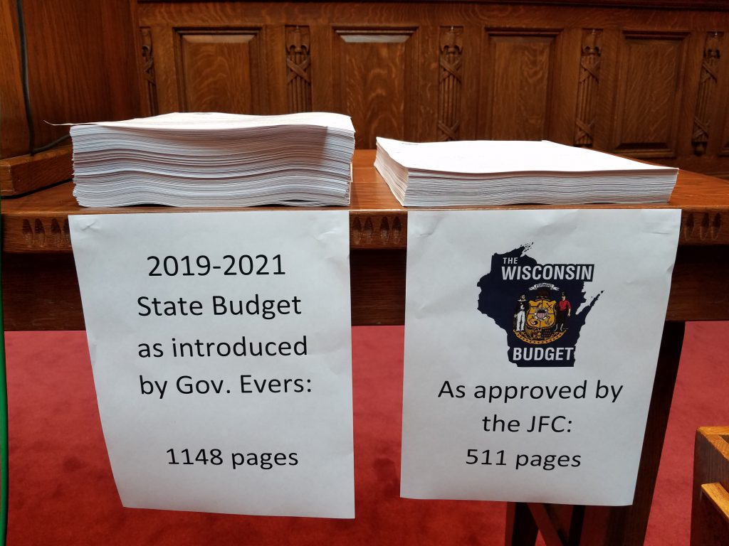 Republicans stacked a paper copy of Gov. Tony Evers' budget bill next to their own on the day the Wisconsin Assembly passed its version of a two-year spending plan. The GOP budget bill is the shortest in decades. Photo by Shawn Johnson/WPR.