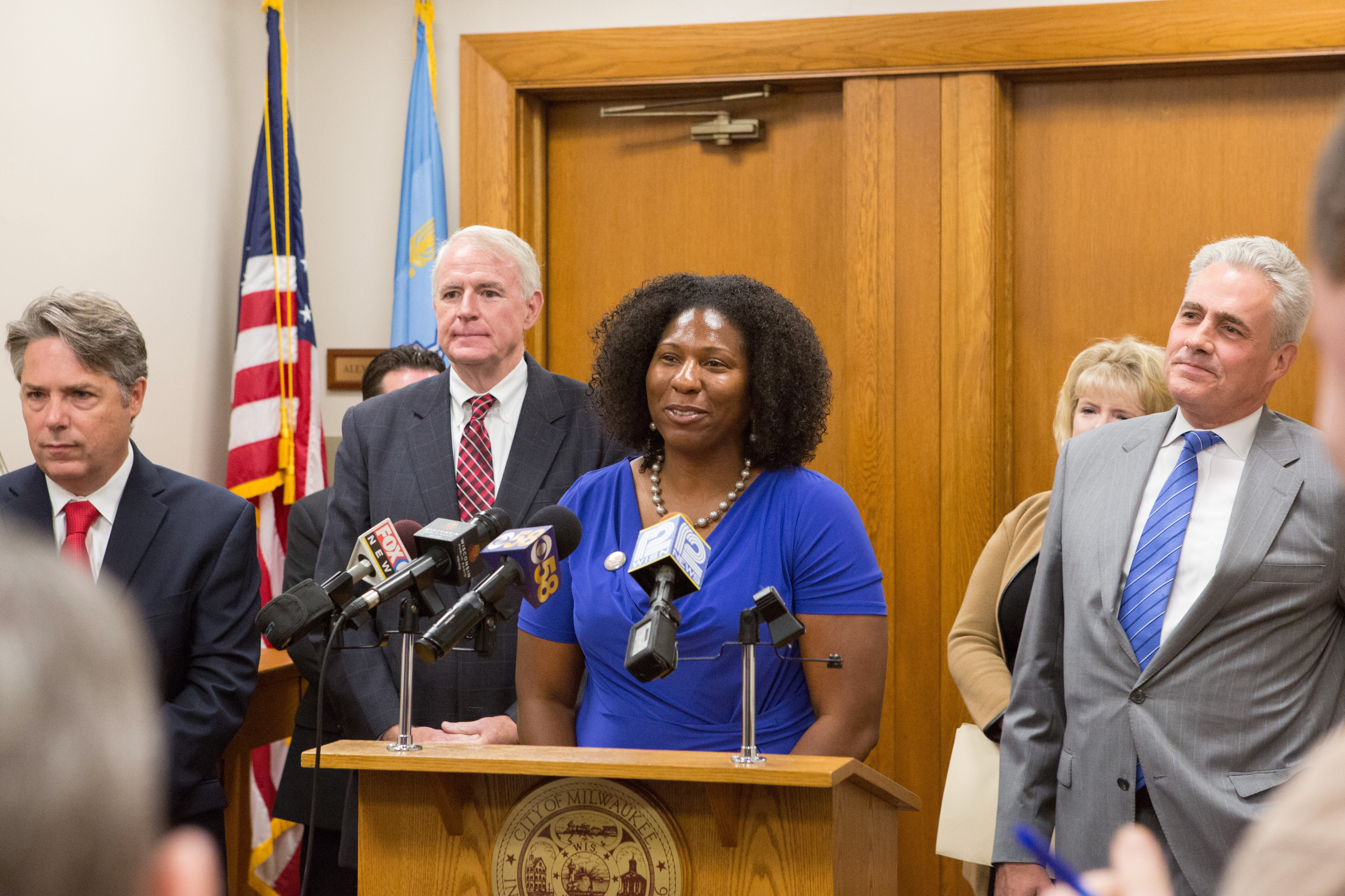 Keisha Krumm speaks at a news conference at City Hall in 2015 at which Nationstar Mortgage announced it would contribute $30.5 million to help Sherman Park homeowners recover from the foreclosure crisis. Photo courtesy of Common Ground.