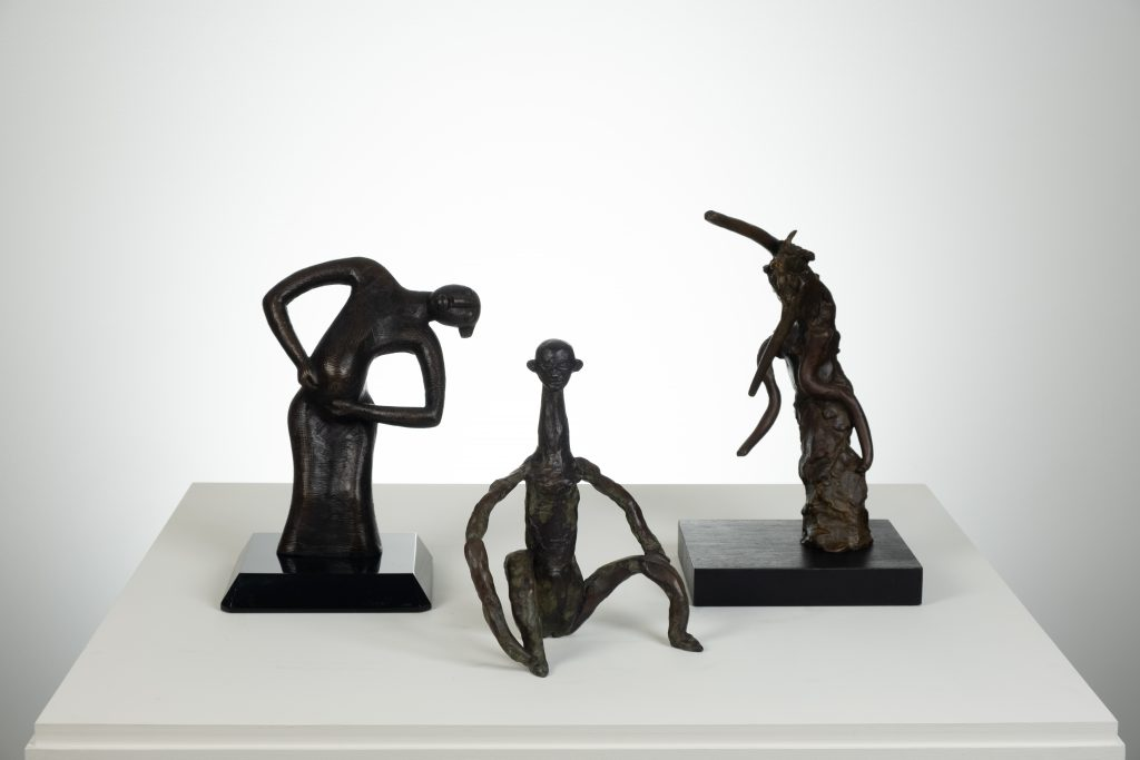 "(from left to right) ""Dancing Pregnant Figure"" (1993) by Peter BOngani Shange, ""Figre 132"" (2006) by Dietrich Klinge, and ""Untitled"" (unknown) by Reuben Nakian. Photo by Robb Quinn courtesy of The Warehouse."