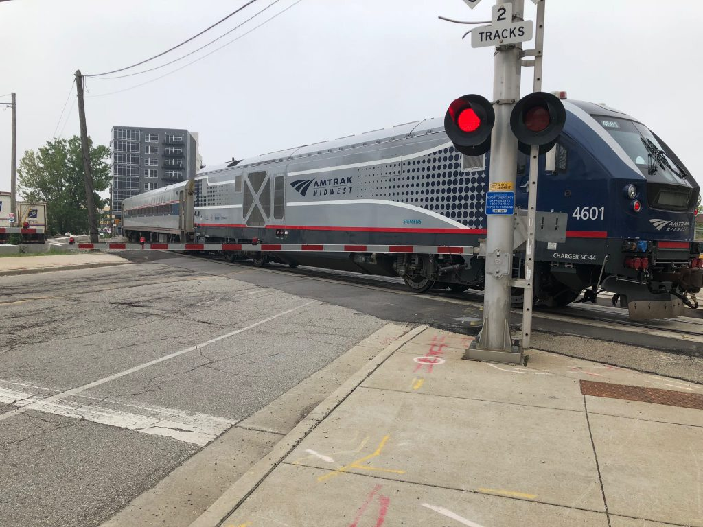 An Amtrak Hiawatha Service train crosses N. Plankinton Ave. near the Milwaukee Intermodal Station. Photo by Jeramey Jannene.
