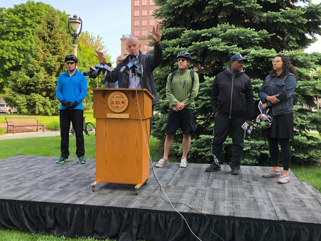 Mayor Tom Barrett with Alderman Tony Zielinski, Ald. Nik Kovac, DPW Commissioner Jeff Polenske, Ald. Ashanti Hamilton and Caressva Givens at Wisconsin Bike Week press conference. Photo by Jeramey Jannene.