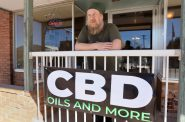 Tim Murphy runs the Kickapoo Kind CBD and hemp shop in Viroqua, Wis., with his wife, Noelle Kehoe. They established Kickapoo Kind in July 2018 and moved to a new larger location on Main Street nine months later. Acceptance of cannabis and products containing it has grown in recent years as states have legalized it for medicinal and recreational use. CBD, or cannabidiol, is legal in Wisconsin, but marijuana remains illegal. Photo by Emily Hamer/Wisconsin Watch.