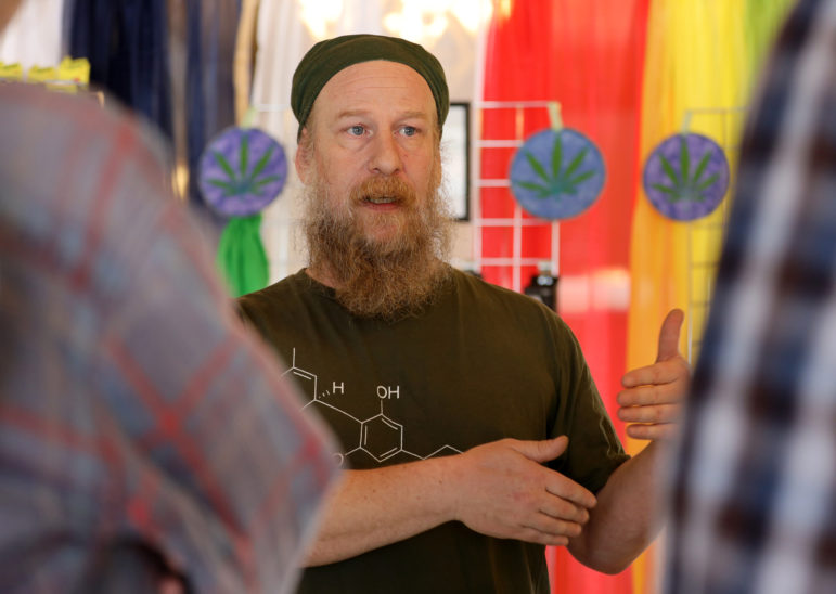 Kickapoo Kind owner Tim Murphy talks to customers in his CBD and hemp shop in Viroqua, Wis., on April 19, 2019. CBD stands for cannabidiol, an active ingredient cannabis. CBD contains just trace amounts or no THC, the psychoactive chemical found in the plant. Photo by Emily Hamer / Wisconsin Watch.