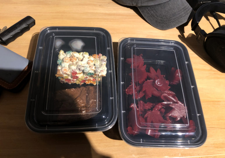 "Wisconsin Watch reporter Rachelle Wilson arranged the sale of a ""book bundle"" from BlazeMichigan, a Michigan business that sprung up after state voters legalized recreational marijuana in 2018. Sales are still banned, but enterprising entrepreneurs have devised ways to ""gift"" marijuana. In this case, edibles including a brownie, a marshmallow treat and gummies containing cannabis came free with the purchase of two used books for $65. Photo by Rachelle Wilson / Wisconsin Watch."