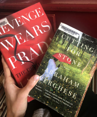 "Wisconsin Watch reporter Rachelle Wilson purchased two books for $65 from BlazeMichigan, a business that sprung up after state voters legalized recreational marijuana in 2018. She received two random used books, as well as a ""gift"" of edibles including a brownie, a marshmallow treat and gummies containing cannabis for $65. Photo by Rachelle Wilson / Wisconsin Watch."