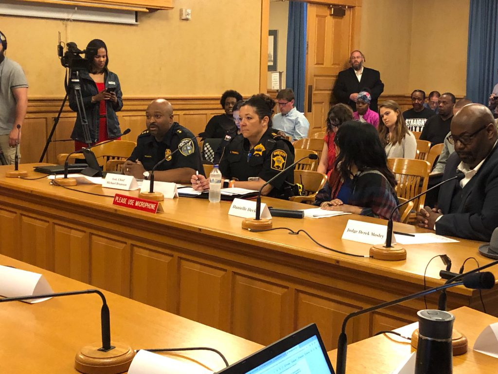 Milwaukee Assistant Police Chief Michael Brunson, left, speaks at the City-County Carjacking and Reckless Driving Taskforce meeting Monday, June 24, 2019, at city hall. Photo by Corrinne Hess/WPR