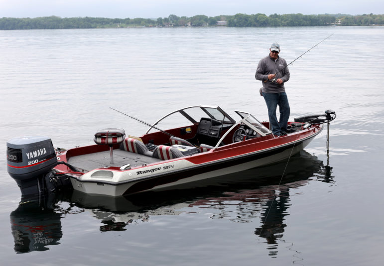 Kevin Reis fishes for walleye on Lake Monona in Madison, Wis., on May 29, 2019. A lifelong Madison resident, Reis has been fishing on lakes Mendota and Monona since he was a child. He said he eats about a dozen walleye a year and does not worry about mercury contamination. Photo by Coburn Dukehart/Wisconsin Watch.