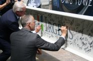 Mark Irgens and Jud Snyder sign the highest beam in BMO Tower. Photo by Jeramey Jannene.