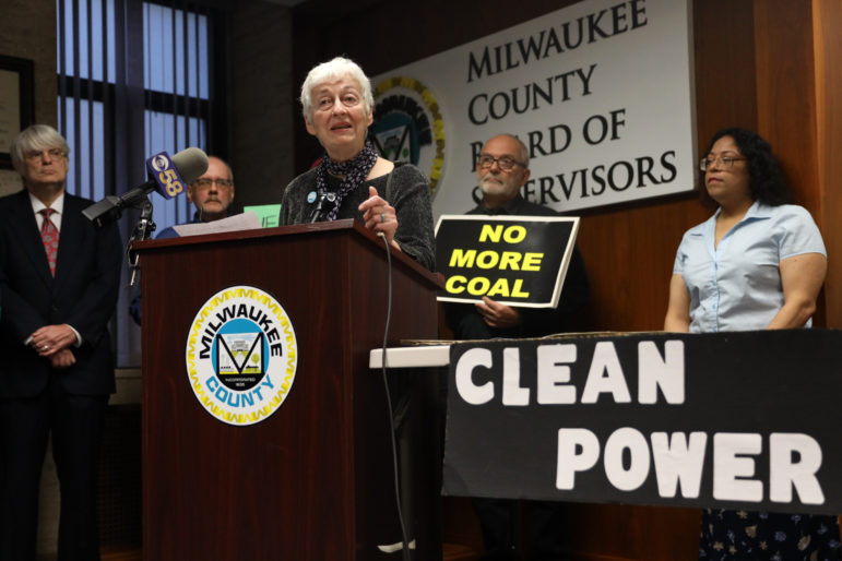 Julie Enslow from the Milwaukee chapter of 350.org speaks at a news conference hosted by the Sierra Club in Milwaukee on April 25, 2019. She and others oppose We Energies' request for a variance in the way mercury is measured in discharge water from the Oak Creek power plants near Milwaukee. Photo by Coburn Dukehart/Wisconsin Watch.