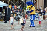 Children dance with the Secure Parking mascot at the Night Market. Photo by Jack Fennimore.
