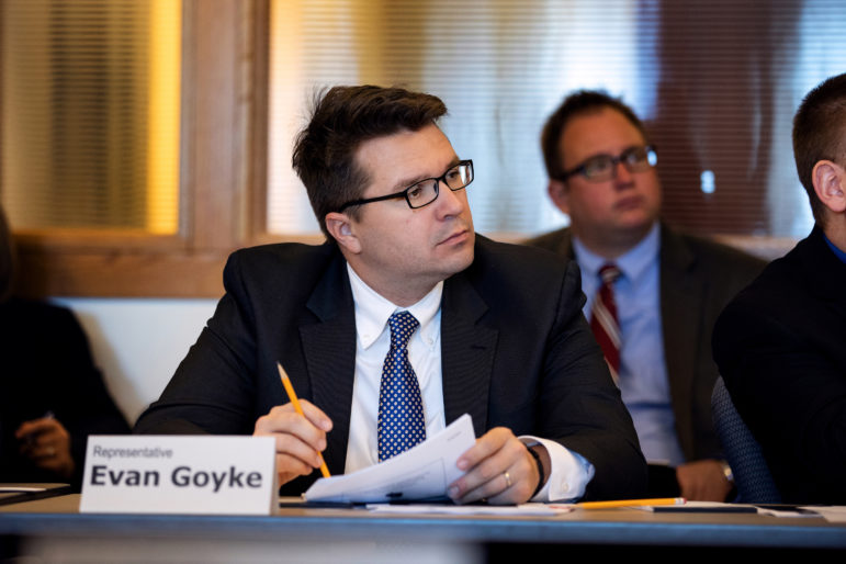 Rep. Evan Goyke, D-Milwaukee, a member of the Assembly Corrections Committee, says he favors reducing the practice of reincarcerating offenders for community supervision rule violations. Goyke is seen here on Oct. 16, 2018, at a Legislative Council meeting in Madison, Wis. Photo by Emily Hamer / Wisconsin Watch.