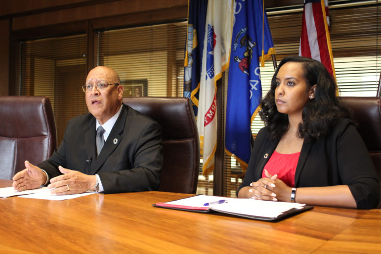 Wisconsin Department of Corrections head Kevin Carr describes various strategies for achieving Gov. Tony Evers' goal of sharply reducing the state's prison population. Wisconsin was among 19 states where prison populations increased in 2018. The system is currently 33 percent above capacity. Carr is seen during an interview with Wisconsin Watch at the DOC headquarters in Madison, Wis., on June 19, 2019. He is seen here with Makda Fessahaye, Administrator for the Wisconsin Department of Corrections Division of Adult Institutions. Photo by Alisa Ivanitskaya / Wisconsin Watch.