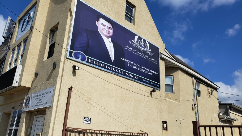 A second banner hangs from the La Luz Del Mundo Family Services, 1570 W. Greenfield Ave. Photo by Edgar Mendez/NNS.