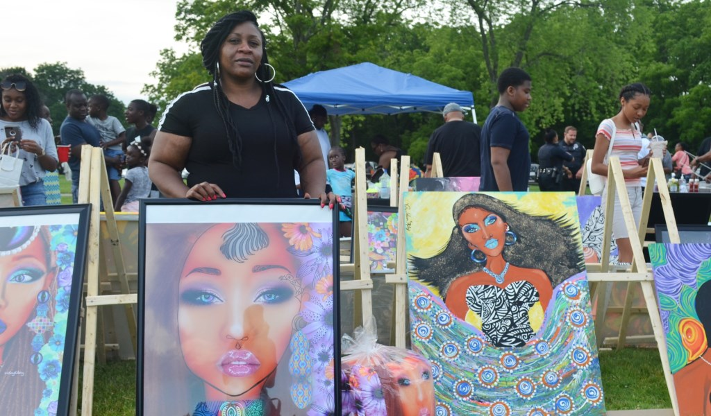Viola Johnson Riley is pictured with art at the African Cultural Festival. Photo by Jack Fennimore.