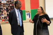 HUD Secretary Ben Carson talks to Dr. Michele Bria, CEO of Journey House, during his tour of the facility after a July 26, 2019 press conference announcing a new HUD program to help at-risk youth. Photo by Alana Watson/WPR.