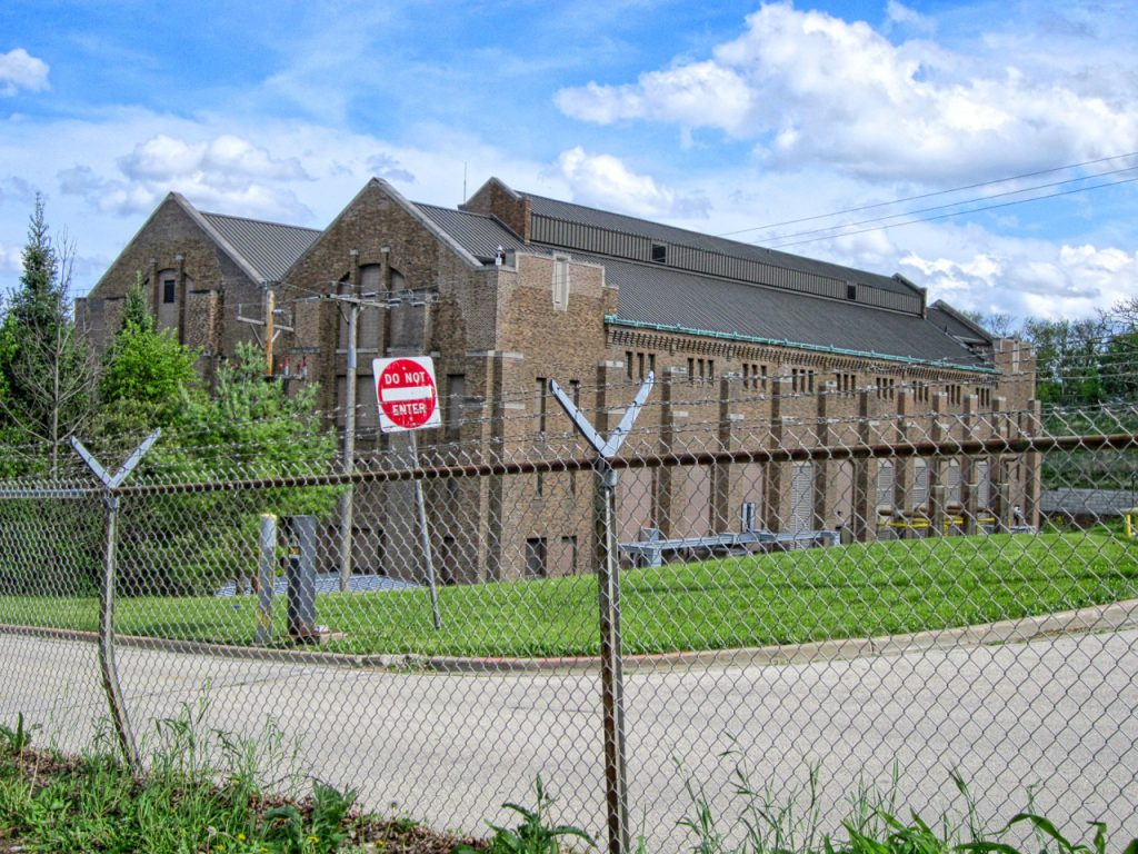 The Milwaukee River pumping station was once a tourist attraction, complete with visitor's gallery. Today it is closed off by fences and surrounded by security cameras. The former boiler house is at right, the pump house is at left. Photo by Carl A. Swanson.