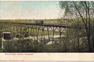 A postcard, dated 1909, shows a streetcar crossing the viaduct. The 2,085-foot-long Wells Street viaduct was the Milwaukee streetcar system's greatest engineering feat. Built in 1892, it remained in service until the end of trolley service in 1958. Photo courtesy of Carl A. Swanson,